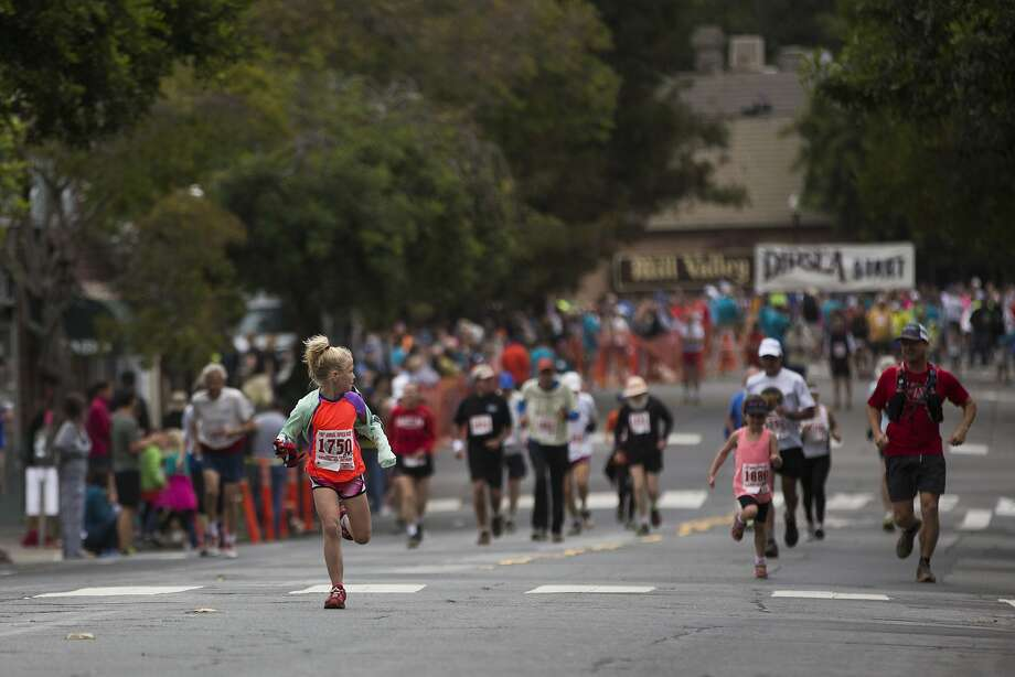 Seven-year-old Kristen Slatter of Mill Valley glances back as she runs along Throckmorton Avenue during the 105th annual Dipsea Race. Photo: Stephen Lam, Special To The Chronicle