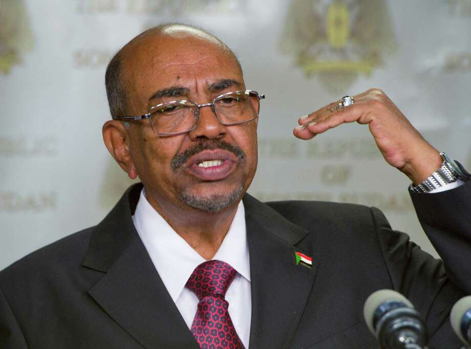 FILE - In this Monday, Jan. 6, 2014 file photo, Sudanese President Omar al-Bashir speaks after meeting with South Sudan's President Salva Kiir, in the capital Juba, South Sudan. A South African judge has ordered authorities to prevent Sudanese president, Omar al-Bashir, from leaving the country because of an international order for his arrest, human rights activists said Sunday, June 14, 2015. It was unclear whether authorities would heed efforts to have al-Bashir detained on behalf of the International Criminal Court, if he is indeed in South Africa. (AP Photo/Ali Ngethi, File) Photo: Ali Ngethi, STR / AP