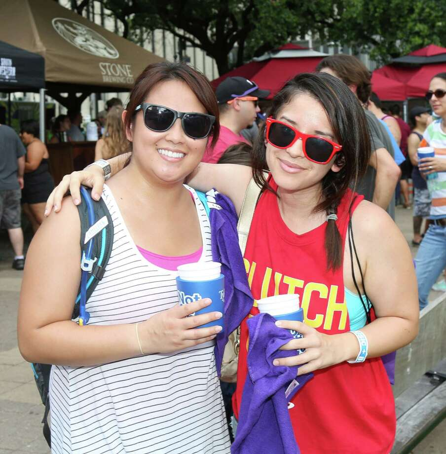 Fans pose for a photo at the Houston Beer Festival at Hermann Square Park Sunday, June 14, 2015, in Houston. Photo: Jon Shapley, Houston Chronicle / © 2015 Houston Chronicle