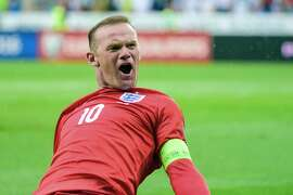 England's Wayne Rooney celebrates after scoring a goal during the Euro 2016 qualifying football match between Slovenia and England at the Stadium Stozice in Ljubljana, on June 14, 2015. AFP PHOTO / Jure MakovecJure Makovec/AFP/Getty Images