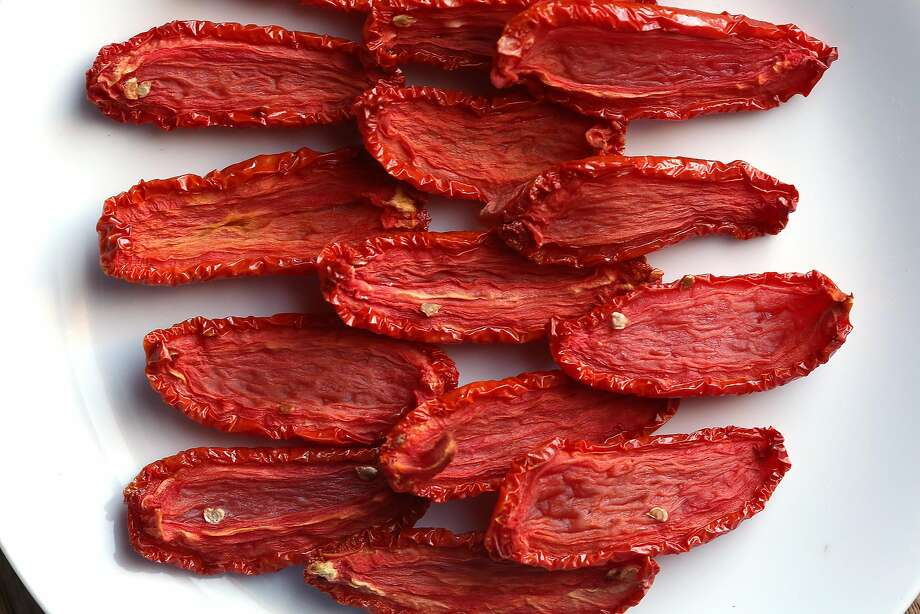 Oven-Dried Tomatoes - can then eat over a few days or preserve in olive oil for months made by Molly Watson in San Francisco, California, on Friday, June 12, 2015. Photo: Liz Hafalia, The Chronicle