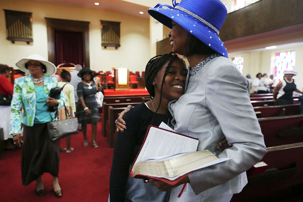 San Antonio Mayor Ivy Taylor hugs her daughter, Morgan, after attending Sunday Service at Greater Corinth Baptist Church, June 14, 2015. Taylor won a close election against former Texas State Senator Leticia Van de Putte Saturday night. Taylor was serving as interim mayor before becoming the first African-American elected to the office in the history of the city.