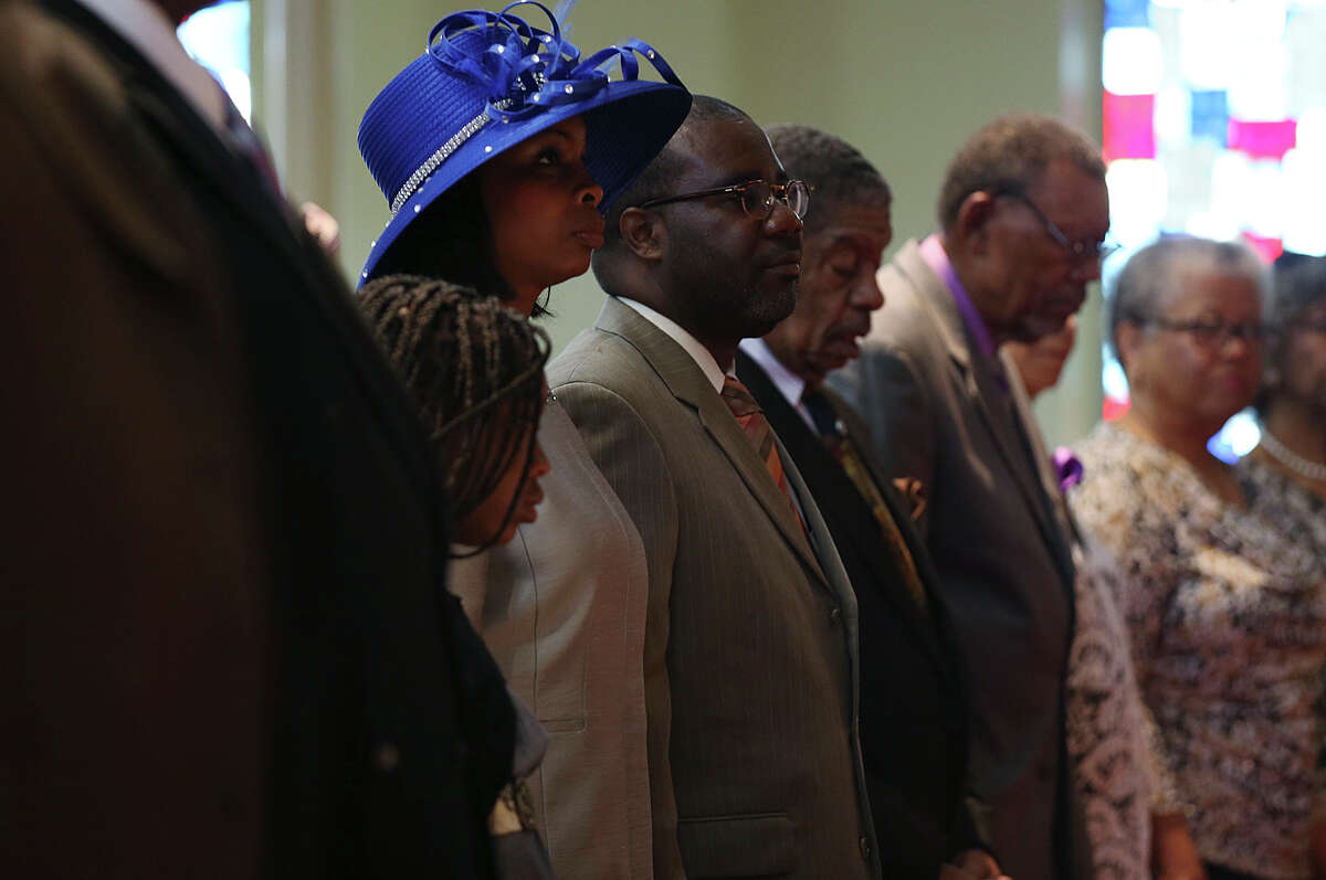 San Antonio Mayor Ivy Taylor is joined by her daughter, Morgan, and husband, Rodney, for Altar Prayer during Sunday Service at Greater Corinth Baptist Church, June 14, 2015. Taylor won a close election against former Texas State Senator Leticia Van de Putte Saturday night. Taylor was serving as interim mayor before becoming the first African-American elected to the office in the history of the city.