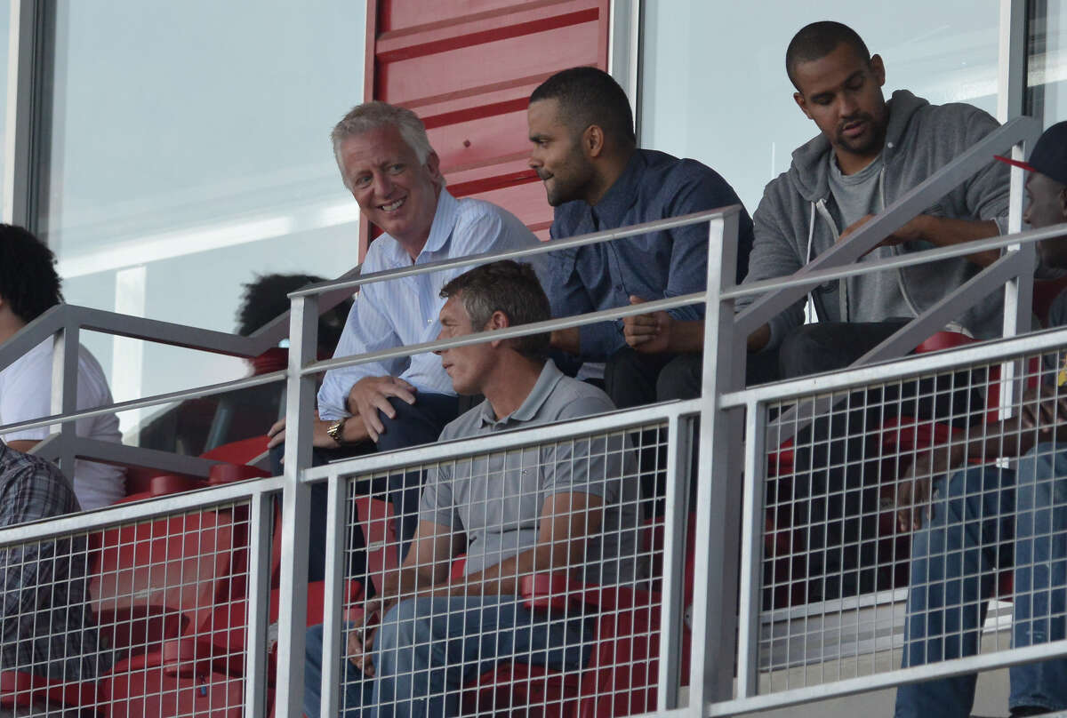 Scorpions owner Gordon Hartman talks with Spurs Tony Parker during the Scorpions' North American Soccer League match against Ottawa in June 2015 at Toyota Field.