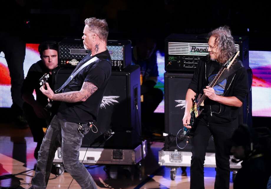OAKLAND, CA - JUNE 14:  Musicians James Hetfield and Kirk Hammett of Metallica perform the national anthem prior to Game Five of the 2015 NBA Finals between the Golden State Warriors and the Cleveland Cavaliers at ORACLE Arena on June 14, 2015 in Oakland, California. NOTE TO USER: User expressly acknowledges and agrees that, by downloading and or using this photograph, user is consenting to the terms and conditions of Getty Images License Agreement.  (Photo by Thearon W. Henderson/Getty Images) Photo: Thearon W. Henderson, Getty Images