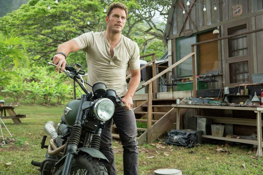"""Product placement pops up in """"Jurassic World"""" as this photo provided by Universal Pictures shows. Chris Pratt, in a scene from the film, asks for a motorcycle and gets one in a behind-the-scene featurette. Photo: Chuck Zlotnick /Associated Press / Universal Pictures"""