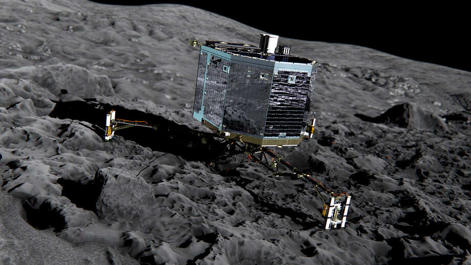 This artist's impression from  2013 shows Rosetta's lander Philae on the surface of comet 67P Churyumov-Gerasimenko. Thanks to instruments aboard the Rosetta orbiter, scientists have spotted patches of water ice on the surface of the comet. Photo: ESA /ATG Medialab, HONS / European Space Agency