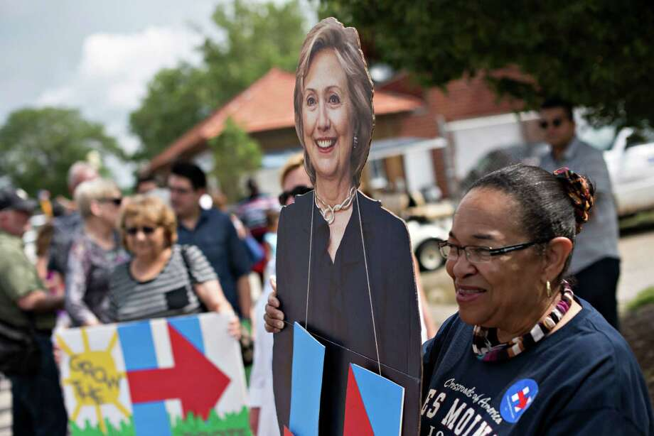 Bobbretta Brewton has her picture taken with a cutout of Hillary Rodham Clinton, as she waits to enter a campaign event in Des Moines, Iowa, Sunday. Photo: Daniel Acker / © 2015 Bloomberg Finance LP