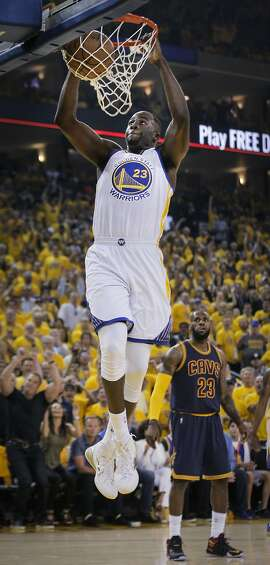 Golden State Warriors' Draymond Green dunks the ball in the first period during Game 5 of The NBA Finals between the Golden State Warriors and Cleveland Cavaliers at Oracle Arena on Sunday, June 14, 2015 in Oakland, Calif.