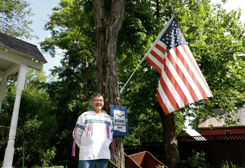 Bruce Callihoo-Cust, 60, stands outside his 150 year old home in Rexford, N.Y. on Wednesday evening, June 10, 2015. (Olivia Nadel/ Special to the Times Union)