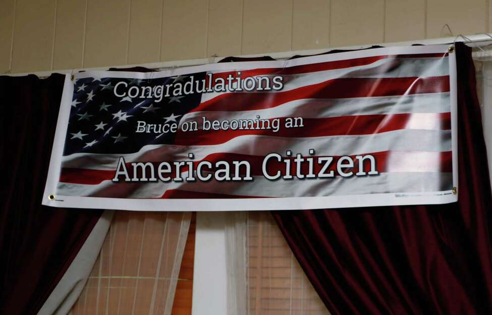 A banner for this Sunday?'s party sits in the living room of Bruce Callihoo-Cust, a North American Indian from Canada living in Rexford who recently became an American citizen, on Wednesday evening, June 10, 2015. (Olivia Nadel/ Special to the Times Union)
