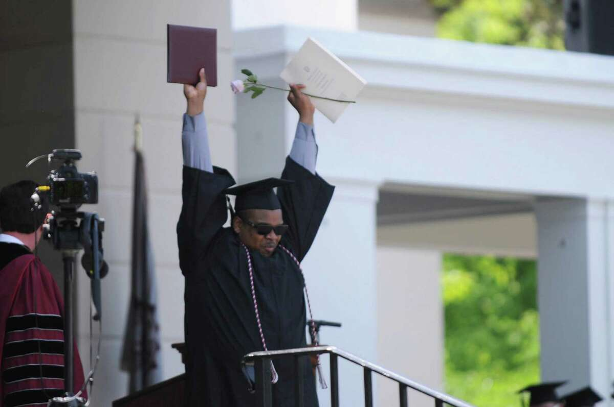 Christopher Brown celebrates after receiving his diploma during the commencement ceremony on Sunday, June 14, 2015, in Schenectady, N.Y. (Olivia Nadel/ Special to the Times Union)