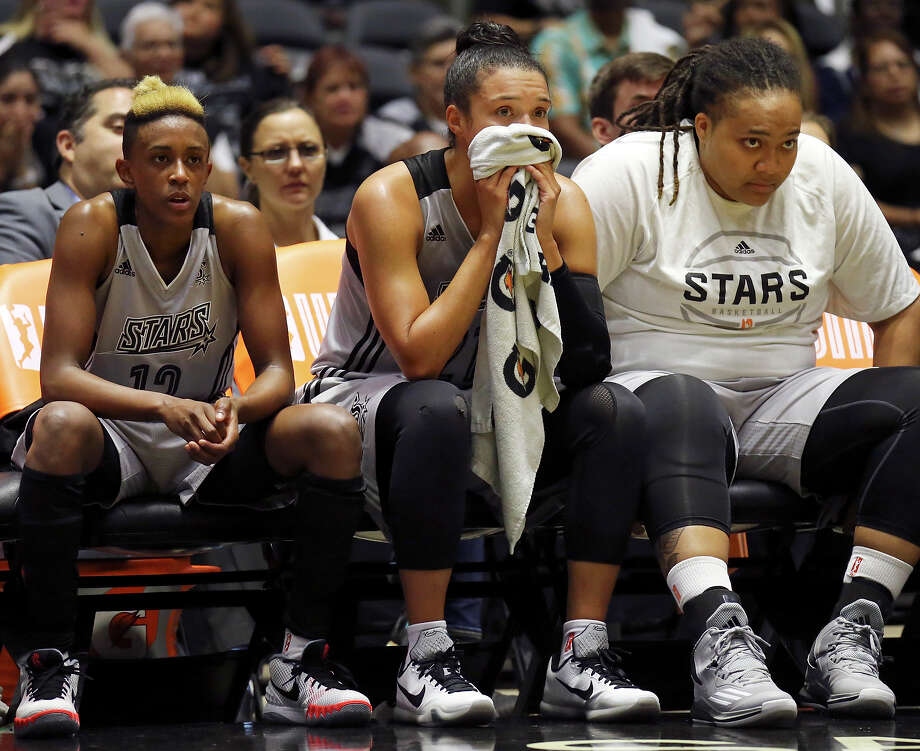 San Antonio Stars' Danielle Robinson (from left), Kayla McBride, and Danielle Adams watch second half action from the bench late in the game with the Tulsa Shock Sunday June 14, 2015 at the Freeman Coliseum. The Shock won 73-62. Photo: Edward A. Ornelas, Staff / San Antonio Express-News / © 2015 San Antonio Express-News