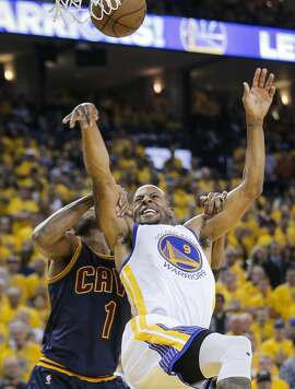 Golden State Warriors' Andre Iguodala is grabbed by Cleveland Cavaliers' James Jones in the second period during Game 5 of The NBA Finals between the Golden State Warriors and Cleveland Cavaliers at Oracle Arena on Sunday, June 14, 2015 in Oakland, Calif.