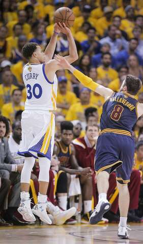0b9392d07869 Golden State Warriors  Stephen Curry shoots a three point shot over  Cleveland Cavaliers  Matthew