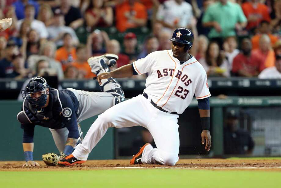 The runs came early and often for the Astros, with Chris Carter scoring for a 3-0 lead in the first inning. Photo: Mayra Beltran, Staff / © 2015 Houston Chronicle
