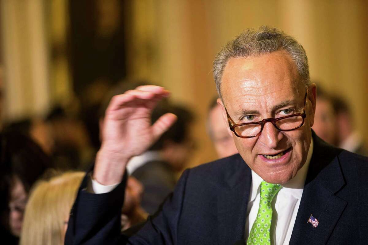FILE - In this May 5, 2015, file photo, Sen. Charles Schumer, D-N.Y., speaks to reporters on Capitol Hill in Washington. Schumer wants airlines to scrap a proposal to reduce the allowed size of carry-on luggage. He planned a news conference Sunday, June 14, 2015, to warn travelers that a 20 percent reduction would force them to pay more for check-in fees or spend money on new luggage. (AP Photo/Brett Carlsen, File) ORG XMIT: NY108