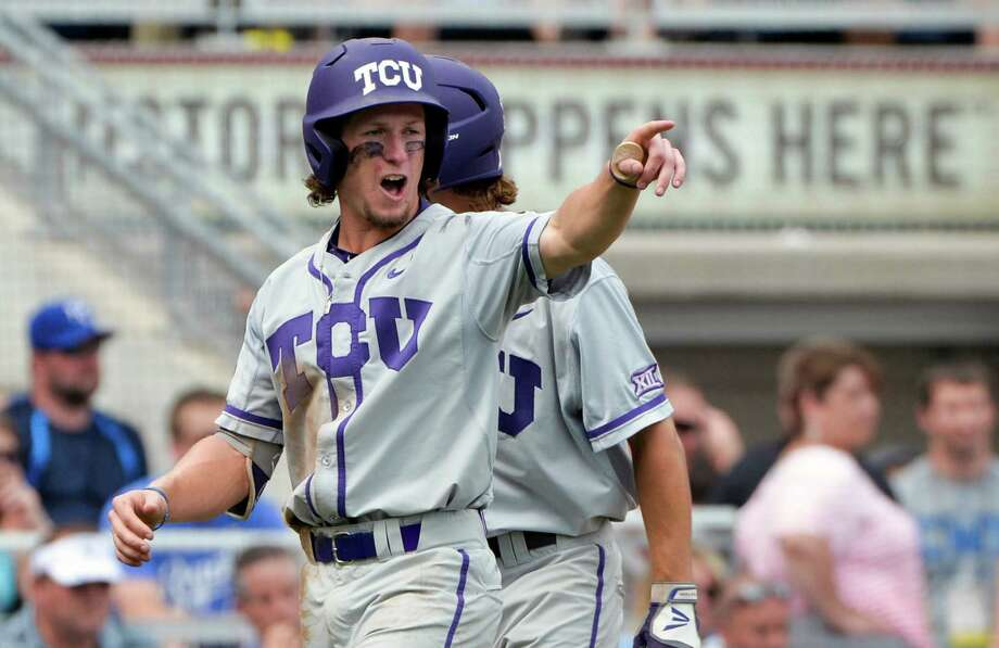 TCU's Cody Jones commends Connor Wanhanen for the hit that scored Jones in the fourth inning. Photo: Ted Kirk, FRE / FR34398 AP