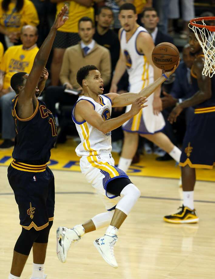 Golden State Warriors' Stephen Curry scores against Cleveland Cavaliers' Tristan Thompson in 4th quarter of Warriors' 104-91 win during Game 5 of NBA Finals at Oracle Arena in Oakland, Calif., on Sunday, June 14, 2015. Photo: Scott Strazzante, The Chronicle