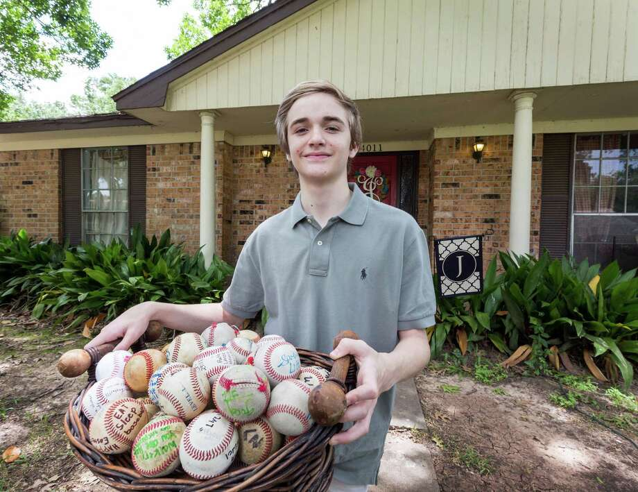 "Walker Johnson celebrates his 14th birthday today, something that didn't appear possible when his heart stopped after he was hit in the chest by a baseball during a game in March. Dozens of ""get well"" baseballs are a memento of his recovery. Photo: Craig Hartley, Freelance / Copyright: Craig H. Hartley"