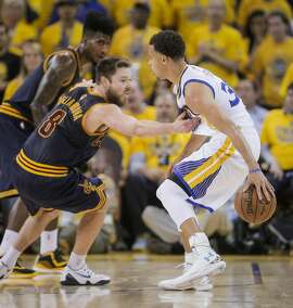 Cleveland Cavaliers' Matthew Dellavedova guards Golden State Warriors' Stephen Curry in the fourth period during Game 5 of The NBA Finals between the Golden State Warriors and Cleveland Cavaliers at Oracle Arena on Sunday, June 14, 2015 in Oakland, Calif.