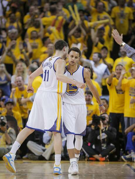 Golden State Warriors' Klay Thompson and Stephen Curry chest bump after Curry's three-pointer in the fourth period during Game 5 of The NBA Finals between the Golden State Warriors and Cleveland Cavaliers at Oracle Arena on Sunday, June 14, 2015 in Oakland, Calif. Photo: Carlos Avila Gonzalez, The Chronicle