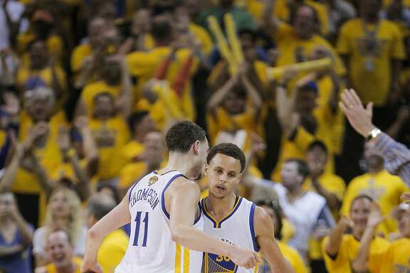 Golden State Warriors' Klay Thompson and Stephen Curry chest bump after Curry's three-pointer in the fourth period during Game 5 of The NBA Finals between the Golden State Warriors and Cleveland Cavaliers at Oracle Arena on Sunday, June 14, 2015 in Oakland, Calif.