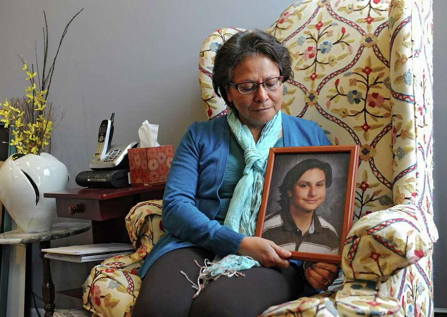 Alicia Barraza holds a framed photograph of her son in her home on Friday, Dec. 12, 2014 in Albany, N.Y. Alicia's son Benjamin Van Zandt hung himself in his prison cell last month at age 21. He had a history of mental illness and was sent to state prison at 17 for arson. (Lori Van Buren / Times Union) Photo: Lori Van Buren / 00029835A