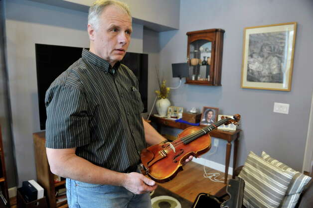 Doug Van Zandt holds the violin that his son played as he talks about his son Benjamin during an interview on Thursday, March 5, 2015, in Albany, N.Y.  Benjamin Van Zandt hung himself in his prison cell a few months ago at age 21.   (Paul Buckowski / Times Union) Photo: PAUL BUCKOWSKI / 10030892A