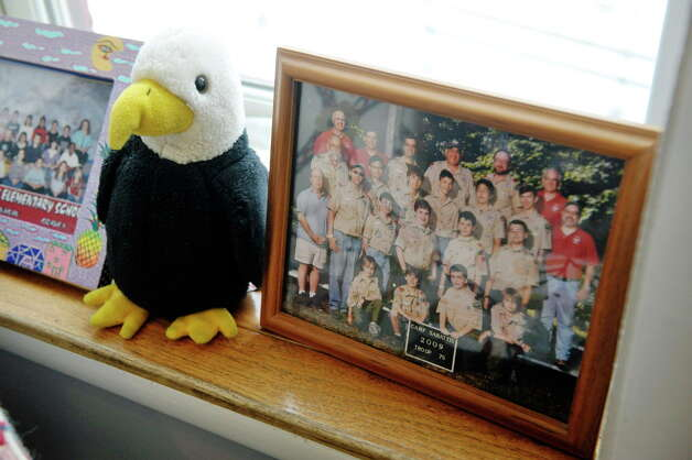 A stuffed eagle and a  photograph of  Benjamin Van Zandt's Boy Scout troop are seen on a shelf at his parent's home on Thursday, March 5, 2015, in Albany, N.Y. Van Zandt hung himself in his prison cell a few months ago at age 21.   (Paul Buckowski / Times Union) Photo: PAUL BUCKOWSKI / 10030892A