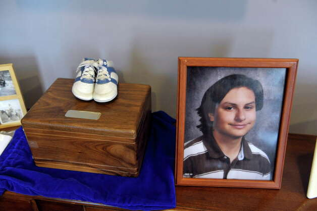 The baby shoes of Benjamin Van Zandt are seen on top of a box containing his ashes, with a picture of Van Zandt next to it, at his parent's home on Thursday, March 5, 2015, in Albany, N.Y.  Benjamin Van Zandt hung himself in his prison cell a few months ago at age 21.   (Paul Buckowski / Times Union) Photo: PAUL BUCKOWSKI / 10030892A