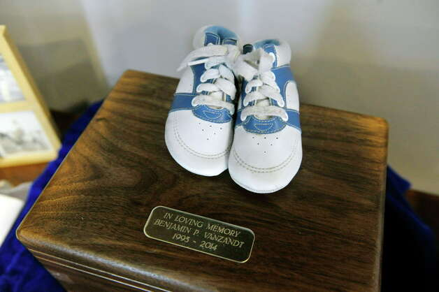 The baby shoes of Benjamin Van Zandt are seen on top of a box containing his ashes at his parent's home on Thursday, March 5, 2015, in Albany, N.Y.  Benjamin Van Zandt hung himself in his prison cell a few months ago at age 21.   (Paul Buckowski / Times Union) Photo: PAUL BUCKOWSKI / 10030892A