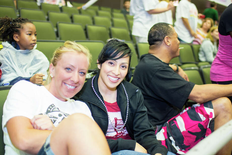 Though the San Antonio Stars fell Sunday night against the Tulsa Shock, Stars' fans would have none of a losing attitude as they cheered their team from start to finish. Photo: By Chavis Barron And Isaiah Matthews/Solarshot