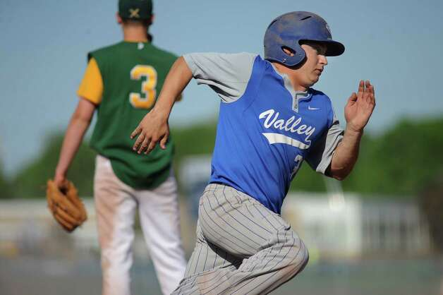 Hoosic Valley's Alex Carlo, right, rounds third and heads for home during their baseball game against Greenwich on Thursday, May 14, 2015, at Hoosic Valley High in Schaghticoke, N.Y. (Cindy Schultz / Times Union) Photo: Cindy Schultz / 10031838A