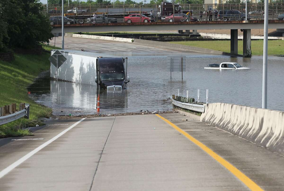 A tractor trailer is seen in the flood waters on 288 North Bound near McGregor in the Medical Center on Tuesday, May 26, 2015 in Houston, TX (Photo: Thomas B. Shea/For the Chronicle)