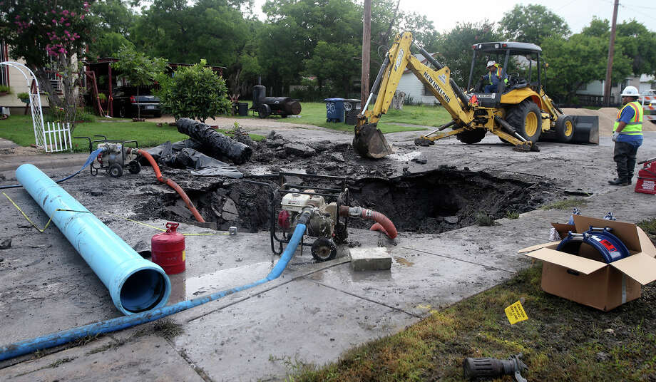 Workers for San Antonio Water System work to repair a water main that broke in the early morning hours of Monday June 15, 2015 on the 300 block of Essex near the intersection of Hackberry on the city's East Side. The crew plans on replacing a broken concrete main with a new pvc pipe. Essex 