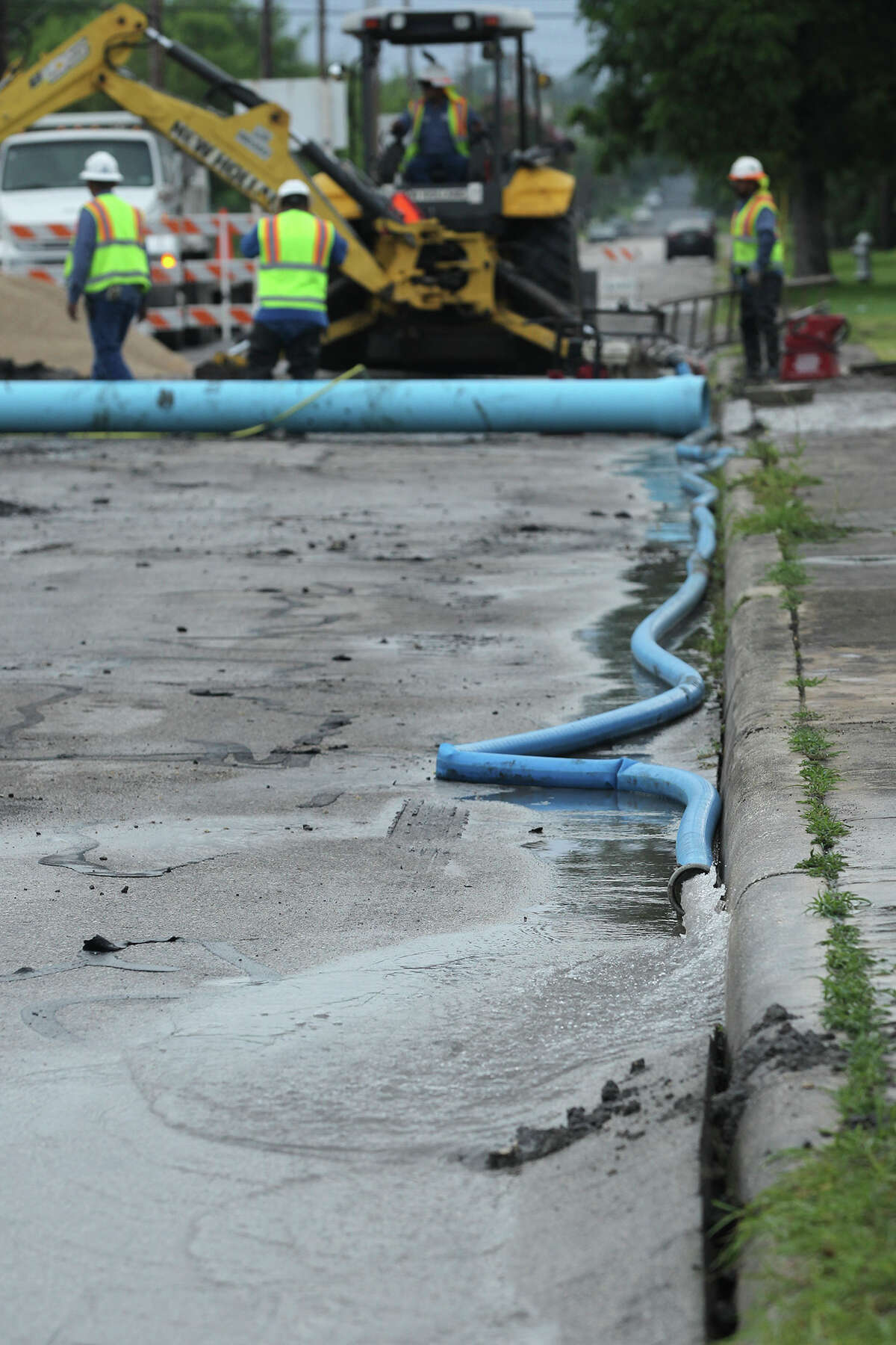 Workers for San Antonio Water System work to repair a water main that broke in the early morning hours of Monday June 15, 2015 on the 300 block of Essex near the intersection of Hackberry on the city's East Side. The crew plans on replacing a broken concrete main with a new pvc pipe. Essex will remian closed most of the day until repairs are completed.