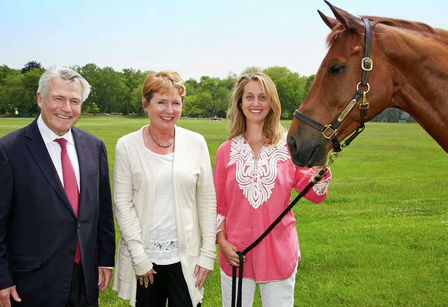 "Preparing for the Terex Jumper Stake at the Fairfield County Hunt Club are, from left, Raymond Condon, member of the Bridgeport Hospital Foundation board of trustees; Susan Warner of the Terex Corp., and Christina Stanton and ""Smiles"" from the hunt club. Photo: Contributed Photo / Contributed Photo / Westport News"