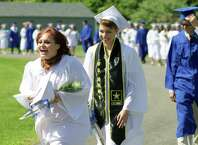 Julianne Collins and Krista Collins march in the processional for the commencement ceremony of the Class of 2015 at Shepaug Valley School in Washington, June 13, 2015