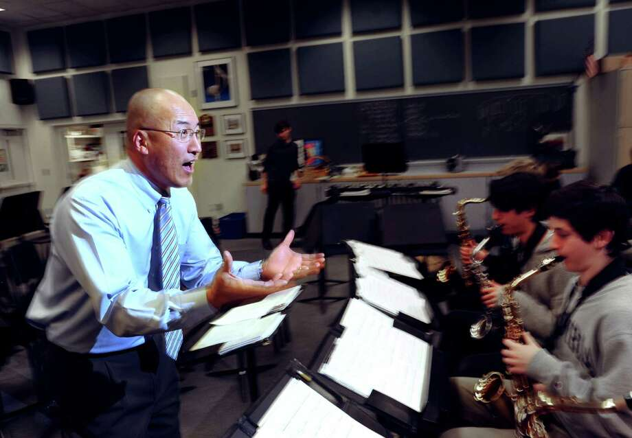 Greenwich High School Band Director, John Yoon, leads his band during rehearsal at the school in Greenwich, Thursday, Jan. 16, 2014. Photo: Bob Luckey / Bob Luckey / Greenwich Time
