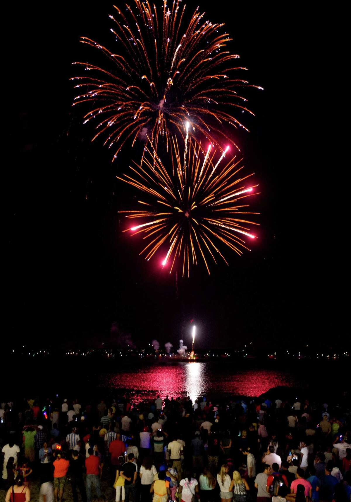 Fireworks light up the sky over Cummings Beach in Stamford last July.