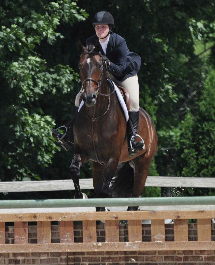 Melissa Exner, of Westport, and her horse Quilano Z were awarded Reserve Champion Ribbons in two Divisions of DarienâÄôs Ox Ridge June 2015 Charity Horseshow held last weekend. Photo: Contributed Photo / Westport News Contributed