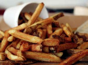 Five Guys Burgers and Fries Regular Fries, 620 calories.