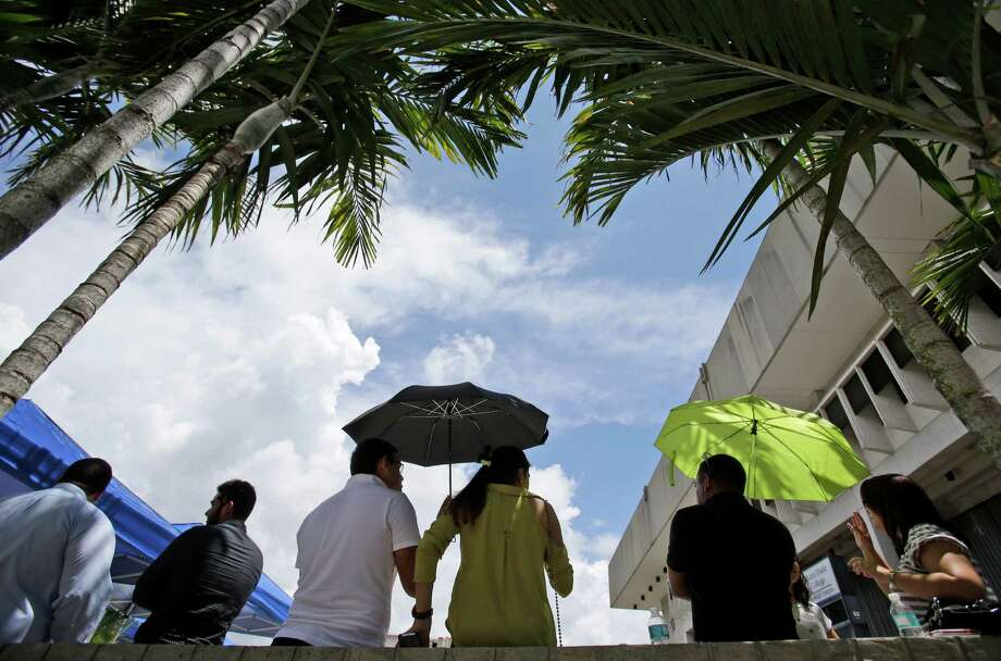 Supporters of former Florida Gov. Jeb Bush wait for the doors to open at Miami Dade College's Theodore Gibson Health Center, before an announcement by Bush at the facility, Monday, June 15, 2015, in Miami. Bush is expected to announce his bid for the Republican presidential nomination. Photo: Wilfredo Lee, AP / AP