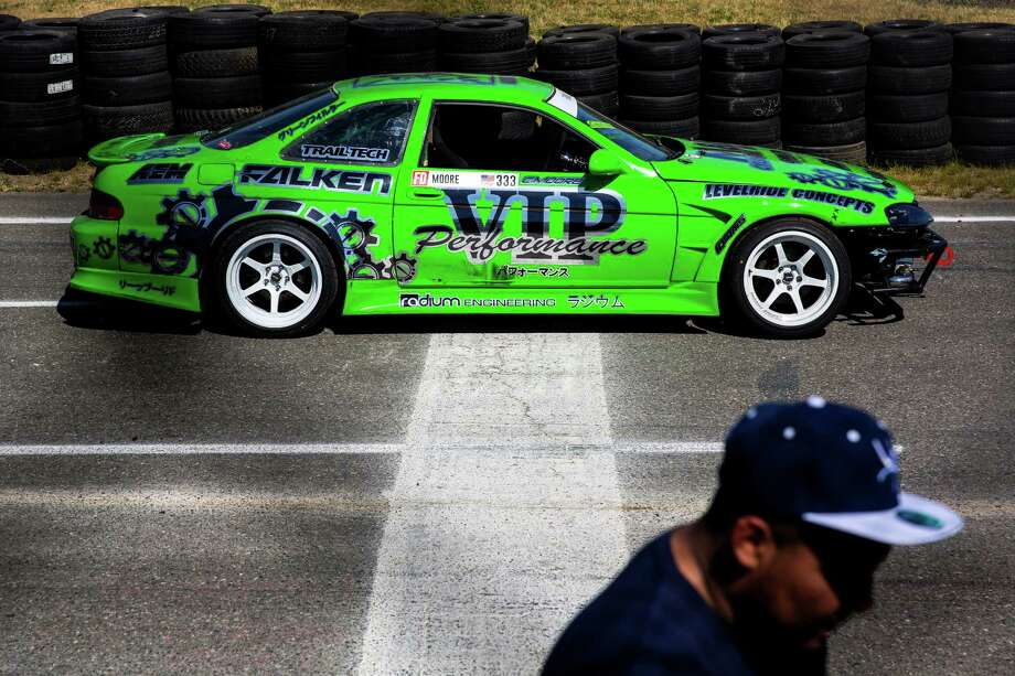Drivers await their chance at the track during DriftCon, an import car show and drift event, photographed Sunday, June 14, 2015, at Evergreen Speedway in Monroe, Washington. Drifting is a worldwide motorsport discipline, judged on speed, angle, showmanship and path that a car takes while navigating through a set of corners. Photo: JORDAN STEAD, SEATTLEPI.COM / SEATTLEPI.COM