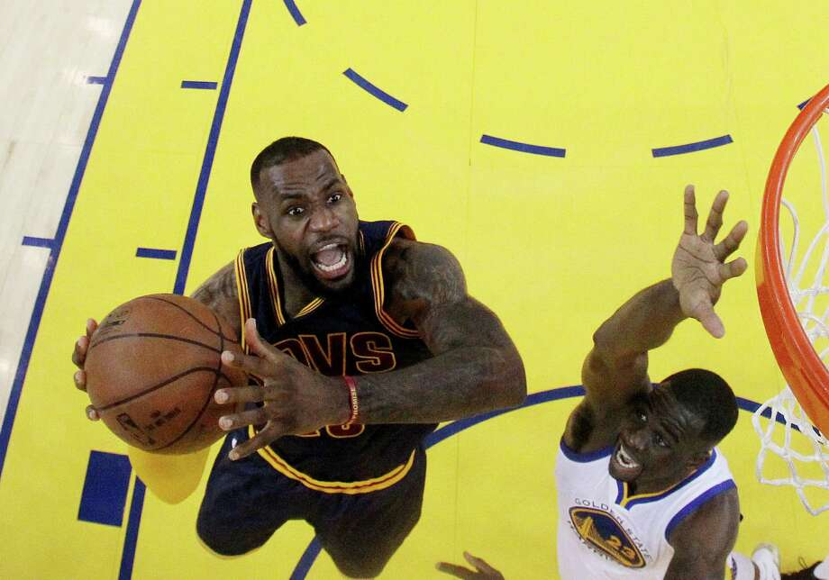 LeBron James of the Cleveland Cavaliers goes up for a shot against Draymond Greenof the Golden State Warriors in the first half during Game 5 of the 2015 NBA Finals on June 14, 2015. Photo: Ezra Shaw /Getty Images / 2015 Getty Images