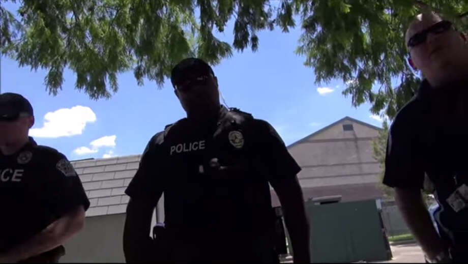 "When Austin police approached an activist conducting a self-described ""First Amendment test"" by filming police facilities, the activist refused to share his name. A standoff ensued with officers handcuffing and detaining the suspect for more than 20 minutes while he persistently refused to share his name. In the end, the officers let him go. Screenshot from: YouTube / The Battousai Photo: YouTube / The Battousai"