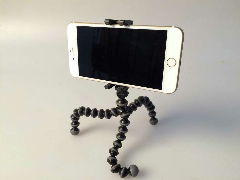 Joby GripTight GorillaPod Stand $29.95 at The Camera Exchange: Like a cute land-roving octopus minus several tentacles, the flexible GripTight GorillaPod Stand wraps around rails, claws onto rocks and perches on just about any other odd surface to capture those moments from those odder angles. Its rubber-foot grips stabilize your phone on just about any terrain, while its rubber pads hold your device in check. The rugged little guy travels well, too, thanks to a foldable, compact design. And it works with phone cases and lenses. Photo: René A. Guzman /San Antonio Express-News