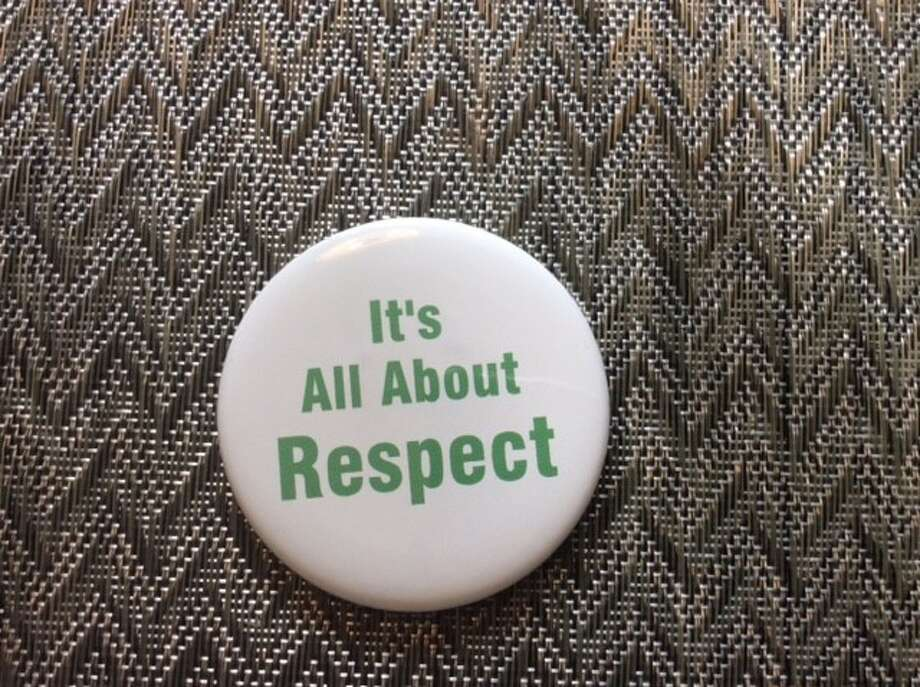 """New Milford teachers are wearing this """"It's All About Respect"""" pin to school. Photo: Contributed Photo"""