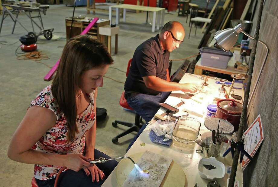 Amanda Thacker and Peter Querubin work on annealing their jewelry on Wednesday, June 3, 2015 at the Makerspace studio in Houston, TX. (Photo: Thomas B. Shea/For the Chronicle) Photo: Thomas B. Shea, Freelance / © 2015 Thomas B. Shea